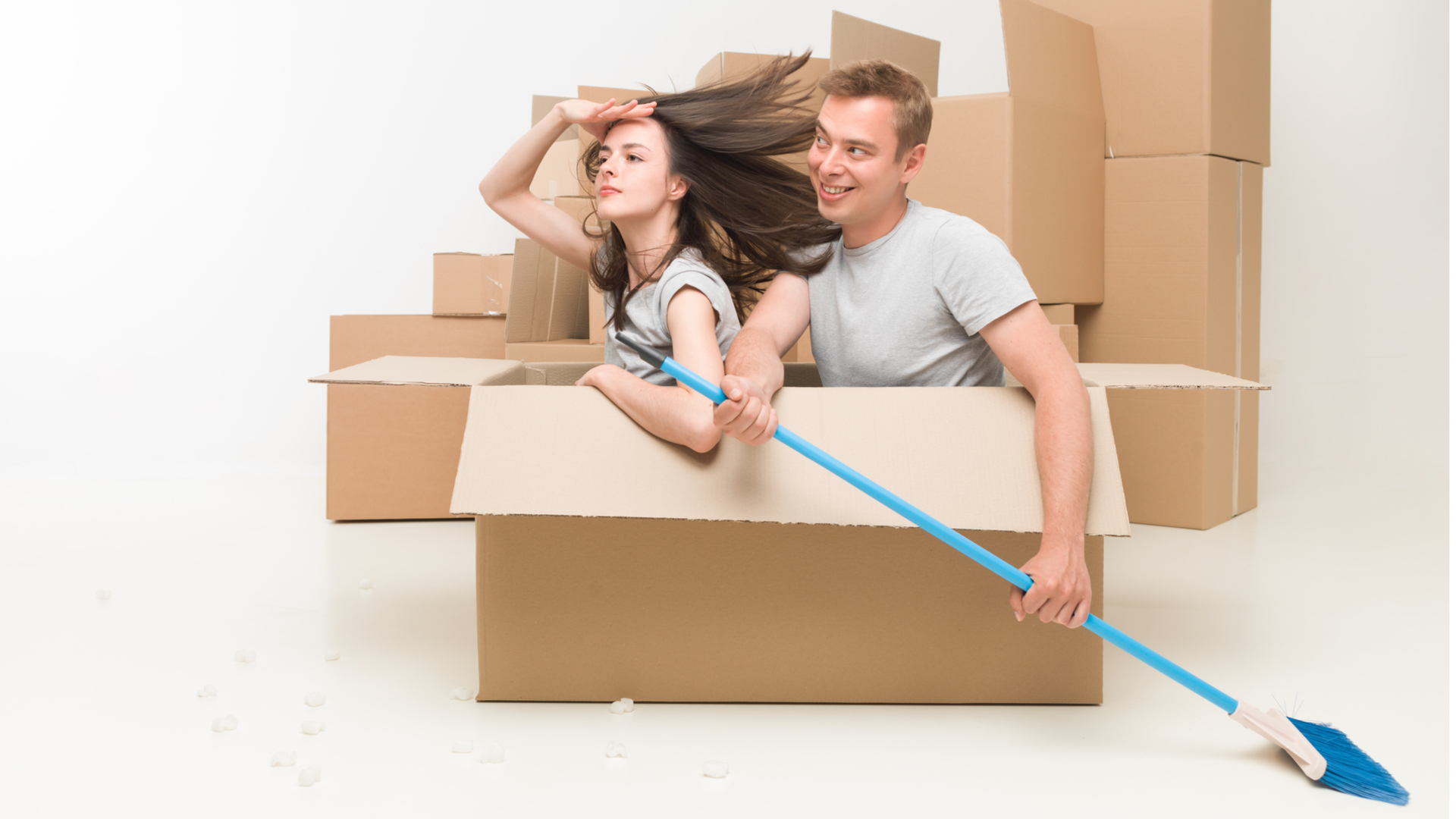 Photo of couple playing in cardboard box