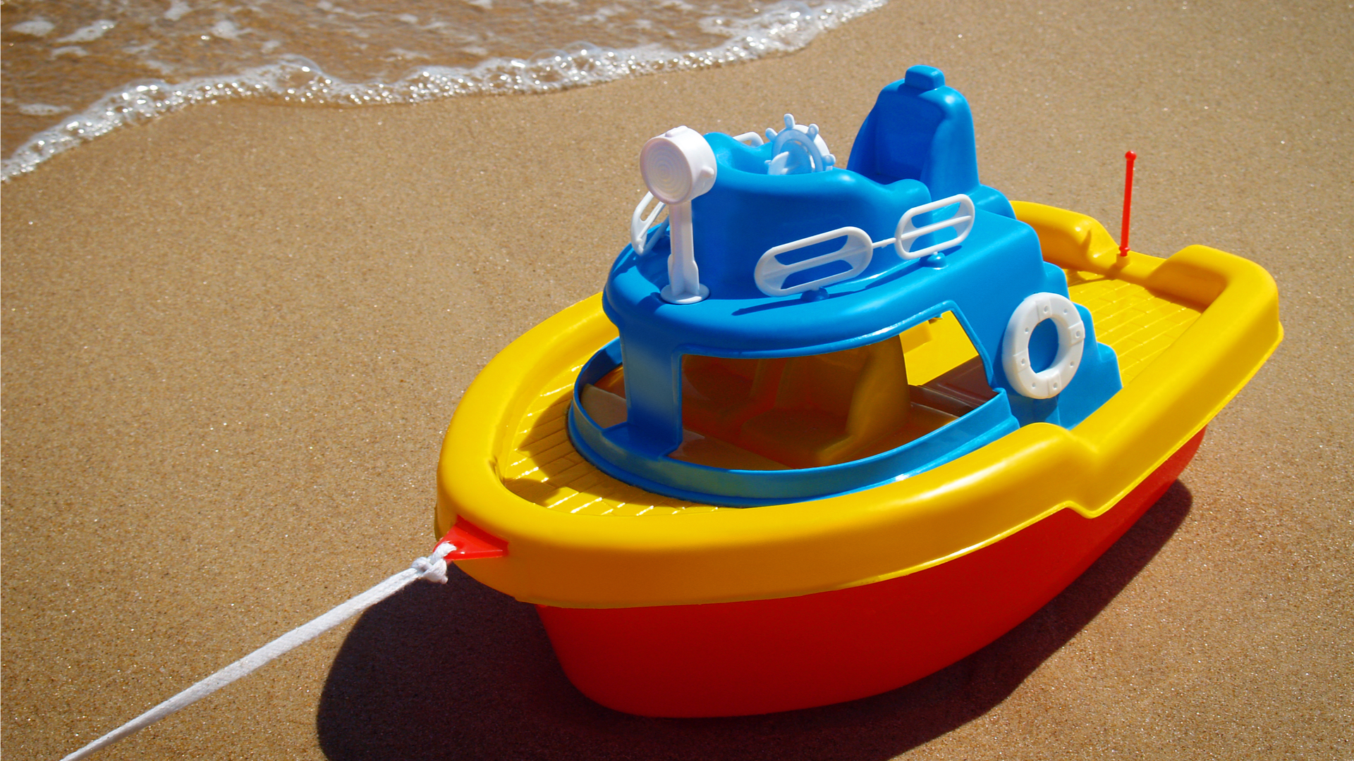 Photo of toy boat on the beach