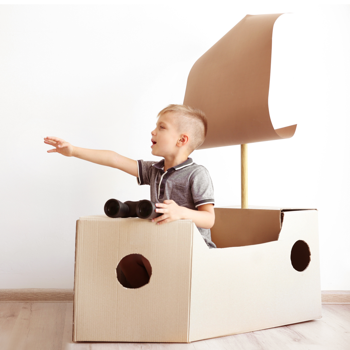 Photo of Child in card board boat