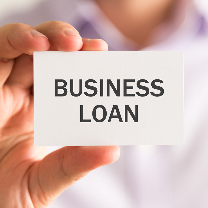 Photo of business card with Business Loans