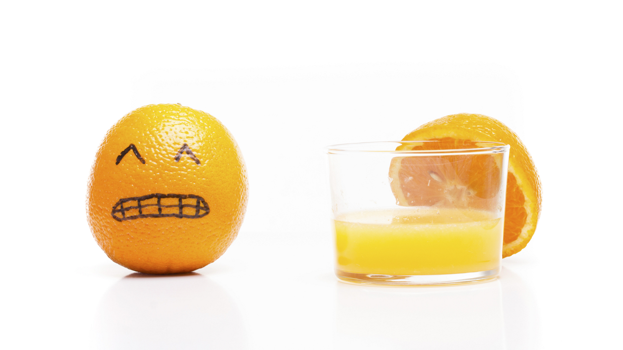 Photo of orange with face drawn on