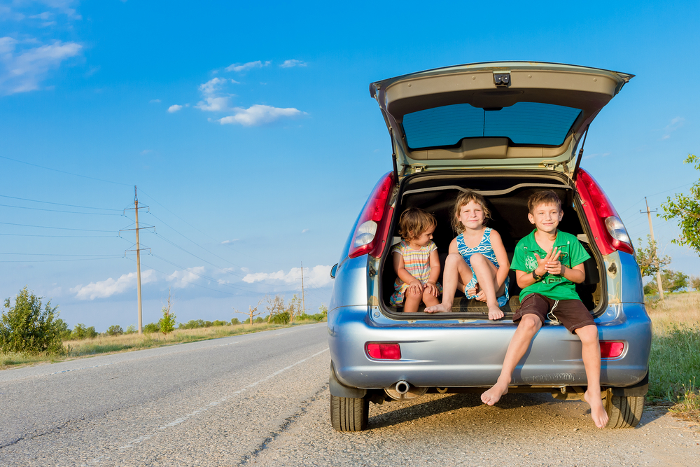 Photo of children sitting on back of car